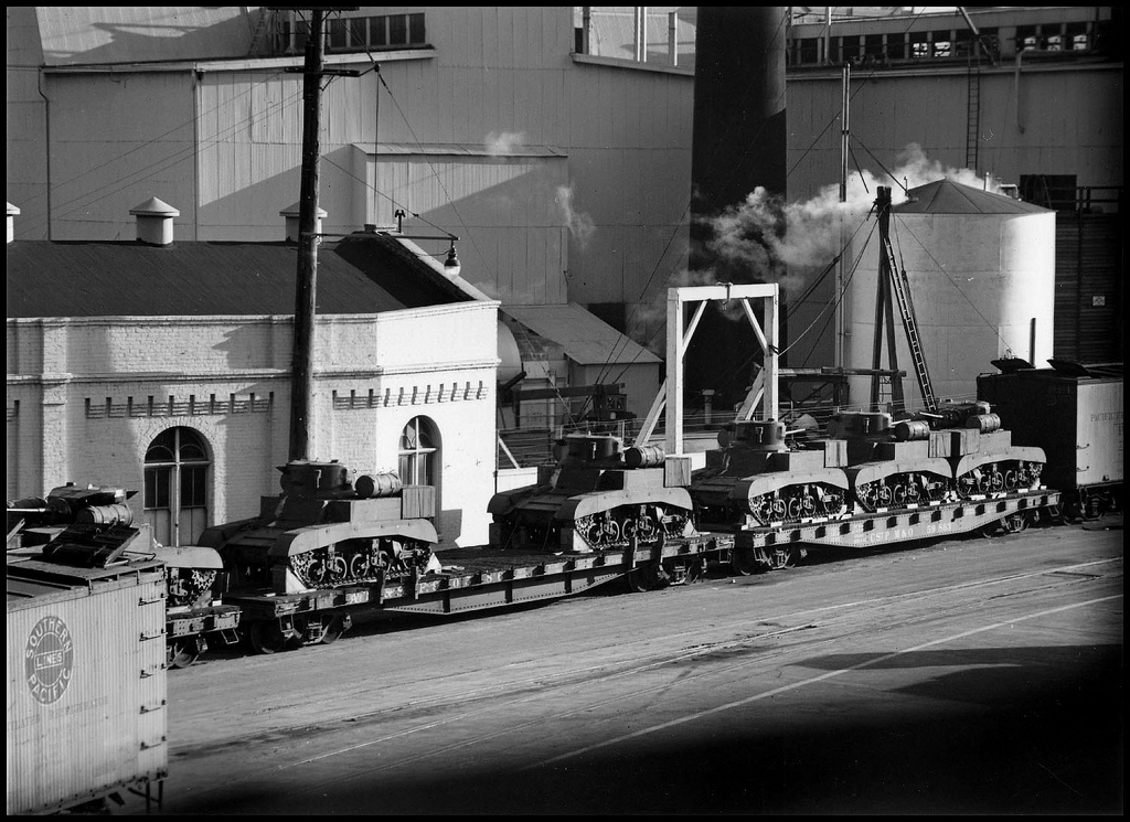 Train carrying tanks past the Grove Street Pier, 1943