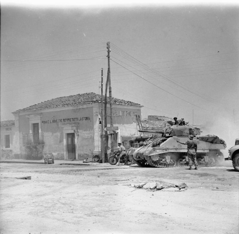 Sherman tank passing through Villasmundo, 13 July 1943.